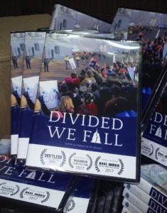 A stack of Divided We Fall DVDs